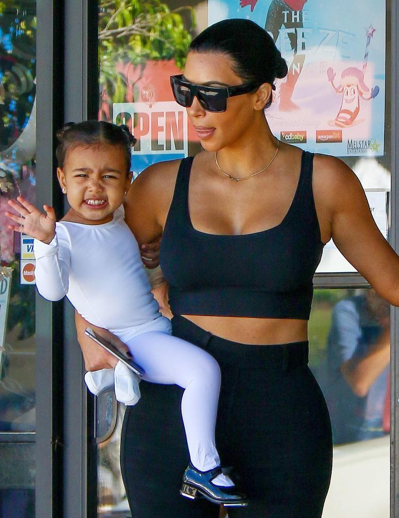 NO JUST JARED USAGE Kim Kardashian and Kourtney Kardashian take the kids to tap dance and ballet dance class in Tarzana. **NO DAILY MAIL SALES** Pictured: Kim Kardashian and North West Ref: SPL985578  270315   Picture by: Splash News Splash News and Pictures Los Angeles:310-821-2666 New York:212-619-2666 London:870-934-2666 photodesk@splashnews.com